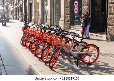 MILAN, ITALY - APRIL 07, 2018: Yellow Mobike bike sharing Milan, a row of bicycles on street early in morning