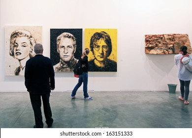 MILAN, ITALY - APRIL 08: People look at paintings galleries during MiArt, international exhibition of modern and contemporary art on April 08, 2011 in Milan, Italy