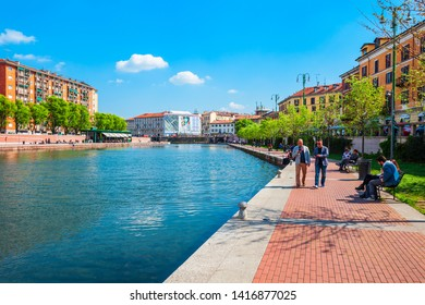 MILAN, ITALY - APRIL 09, 2019: The Darsena artificial reservoir is located near Porta Ticinese in Milan in Lombardy region of northern Italy