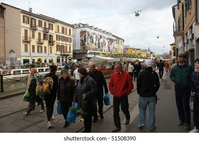 MILAN, ITALY - APRIL 11: People at the annual Flowers Market in the fashion and culture Navigli area April 11, 2010 in Milan, Italy.