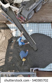 Milan, Italy - April 12, 2016 - Top view of Concrete casting on Reinforcing Bar of floor in industrial Construction site