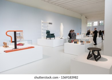 MILAN, ITALY - APRIL 12: People visit Italian Design Museum at Fuorisalone, set of events distributed in different areas of the town during Milan Design Week on APRIL 12, 2019 in Milan.