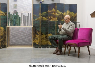 MILAN, ITALY - APRIL 13: Exhibitor is seen in his stand at Miart, international exhibition of modern and contemporary art on APRIL 13, 2018 in Milan.