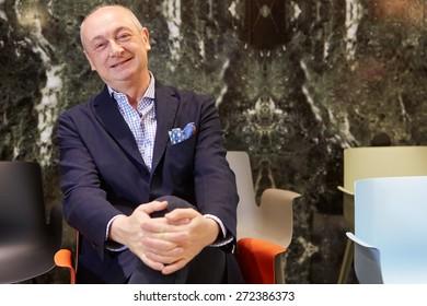 MILAN, ITALY - APRIL 14: Designer Piero Lissoni during Milan Design Week, at Kartell stand at Salone del Mobile opening on April 14, 2015 in Milan.