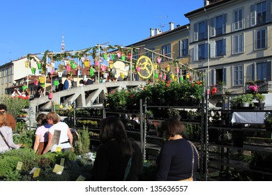 MILAN, ITALY - APRIL 14: Looking at flowers installation on the Navigli bridges during the annual Flowers Market in the fashion and culture Navigli area April 14, 2013 in Milan, Italy.