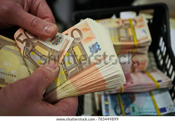 Milan, Italy - April 15, 2014: controlling and counting cash in a bank