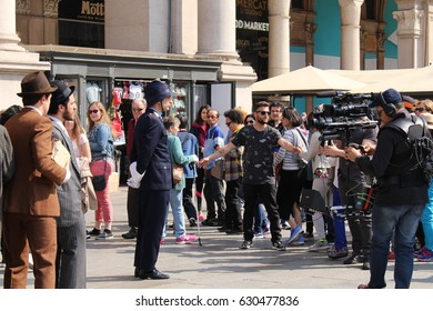 MILAN, ITALY - APRIL 15, 2017: Unidentified actors shooting a history film at Piazza del Duomo square in front of Milan Cathedral (Duomo di Milano).