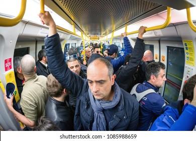 MILAN, ITALY - APRIL 15: Crowded train in Milan metro on April 15, 2018 in Milan