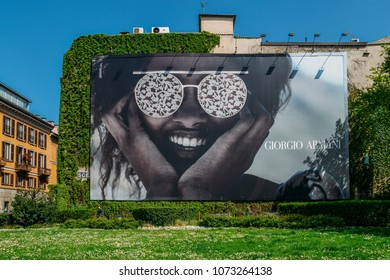 Milan, Italy - April 17, 2018: Illustrative editorial of giant advertisement on wall facade