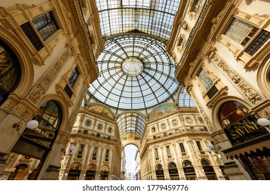 MILAN, ITALY - APRIL 17, 2018. Galleria Vittorio Emanuele II from inside the arcade. View of the glass dome. City of Milan, region of Lombardy, Italy, Europe.