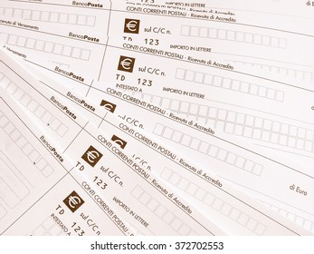 MILAN, ITALY - APRIL 2, 2015: Blank Italian postal order forms for payments, aka as Bollettino Postale in Italy vintage