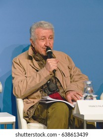 "MILAN, ITALY – APRIL 20, 2017: Franco Falasca, art critic introduces a book on Maurizio Cancelli artist, Fabio D'Ambrosio publisher,  Alice Pareyson translator, at ""Tempo di Libri"" Book Fair in Milan"