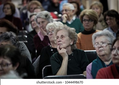 Milan, Italy April 2015: Elderly people listen to a classroom lesson