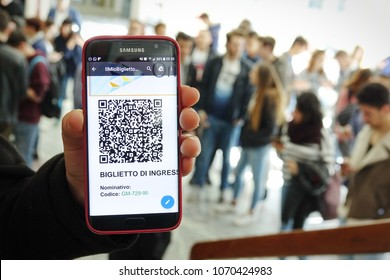 Milan, Italy - April 2018  E-ticket on smartphone screen with people in the blurred background.