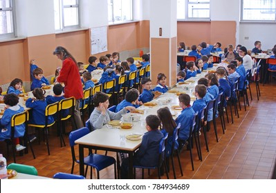 Milan, Italy - April 21, 2012: students eating in the school cafeteria