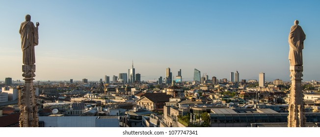 Milan, Italy - April 25, 2018: Panoramic view of the skyline of the city seen from the terraces of Duomo Cathedral at sunset with the skyscrapers of the new financial Porta nuova Garibaldi district.