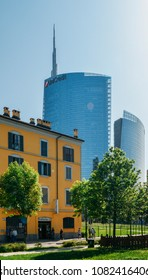Milan, Italy - April 25, 2018: Juxtaposition of traditional Italian building and the Unicredit Building in the Isola district of the city