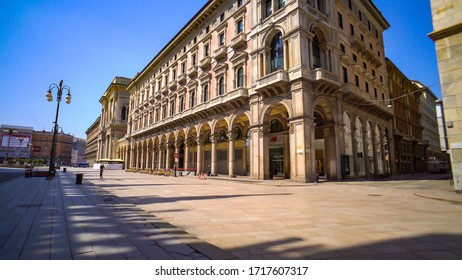 Milan, Italy, April 28, 2020. Empty city streets and galleries on Corso Vittorio Emanuele II without people during quarantine from the coronavirus COVID19. Closed luxury shops, bar. Noise artificial