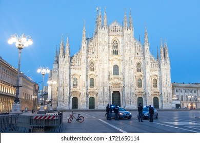 Milan, Italy - April 29, 2020: italian police check point in the main square: Piazza Duomo. Policemen control the respect of the lockdown imposed by the italian authorities to contrast coronavirus