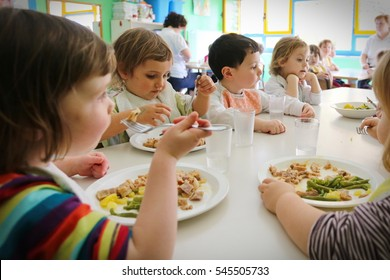 Milan, Italy - April 4, 2014: Pupils Enjoying Healthy Lunch In Cafeteria