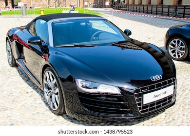 MILAN, ITALY -APRIL 7, 2010: Audi working team preparing to the introduction of various Audi R8 vehicles at the Sforza Castle