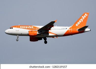 MILAN / ITALY - APRIL 7, 2017: EasyJet Airbus A319 G-EZFY passenger plane landing at Milan Malpensa Airport