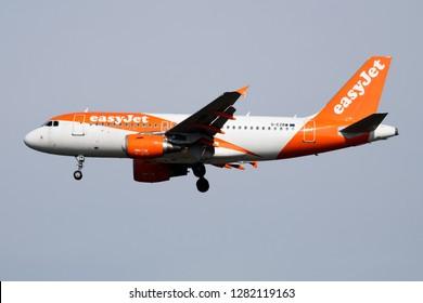 MILAN / ITALY - APRIL 7, 2017: EasyJet Airbus A319 passenger G-EZBW plane landing at Milan Malpensa Airport