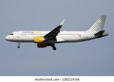 MILAN / ITALY - APRIL 7, 2017: Vueling Airbus A320 EC-LVU passenger plane landing at Milan Malpensa Airport
