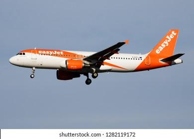 MILAN / ITALY - APRIL 7, 2017: EasyJet Airbus A320 G-EZTJ passenger plane landing at Milan Malpensa Airport