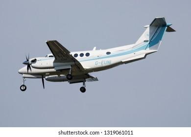MILAN / ITALY - APRIL 7, 2017: Beechcraft B200 G-EUNI private aircraft landing at Milan Malpensa Airport