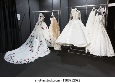 MILAN, ITALY - APRIL 7: Bride dresses in the backstage at Si Sposaitalia just before Amelia Casablanca fashion show on APRIL 7, 2019 in Milan