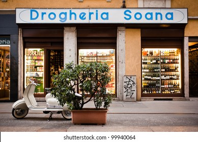 MILAN, ITALY - APRIL 7: A parked Lambretta in front of Drogheria Soana in Milan on April 7, 2012. This typical grocery store has been led by Soana family since 1947 in the historical center of Milan.