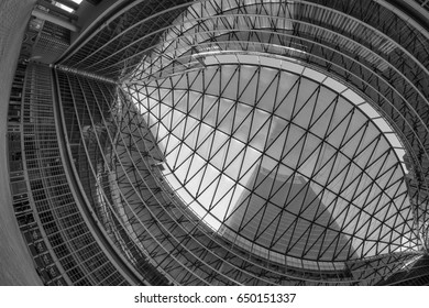MILAN, ITALY - APRIL 8, 2017: Milan (Lombardy, Italy): Palazzo Lombardia, modern building hosting the government of the Region: the glass ceiling of the court. Black and white