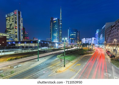 MILAN, ITALY - AUGUST 1, 2017: View of the Unicredit Tower and cars trails from the avenue Luigi Sturzo during the evening. Milan, Lombardy, Italy.