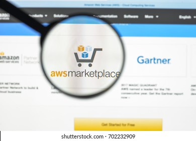 Milan, Italy - August 10, 2017: Amazon web services website homepage. It  is a subsidiary of Amazon.com that provides on-demand cloud computing platforms. AWS logo visible.