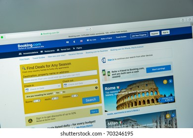 Milan, Italy - August 10, 2017: Booking.com website homepage. It  is a travel fare aggregator website and travel metasearch engine for lodging reservations. Booking logo visible.