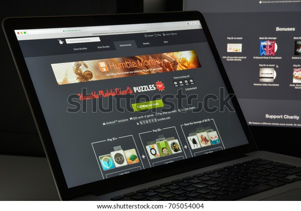Milan, Italy - August 10, 2017: humblebundle.com website homepage. It is a digital storefront for video games, which grew out of its original offering of Humble Bundles. humble bundle logo visible.