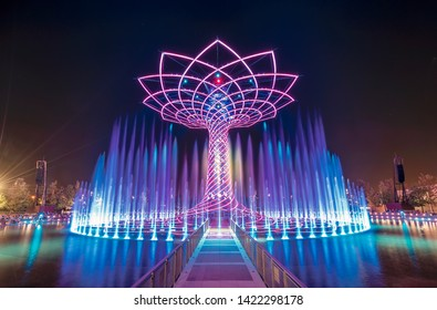 """Milan, Italy - August 13, 2016: EXPO 2015 installation """"Tree of Life"""" with no people in blue at night"""
