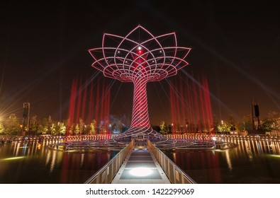 """Milan, Italy - August 13, 2016: EXPO 2015 installation """"Tree of Life"""" with no people in red at night"""