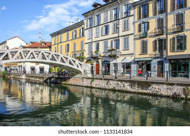 MILAN, ITALY - August 15, 2015: Tourists at the Naviglio Grande canal waterway in Milan Italy