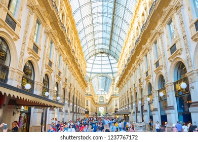 MILAN, ITALY - AUGUST 17, 2017: Crowd of people shopping at Galleria Vittorio Emanuele II, Milan, Italy