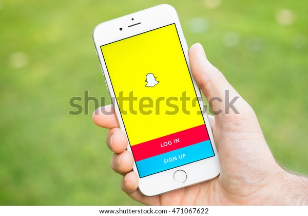 MILAN, ITALY - AUGUST 18, 2016 - Snapchat application on iphone smartphone. Snapchat is a popular mobile messaging application used to share photos, videos, text, and drawings.