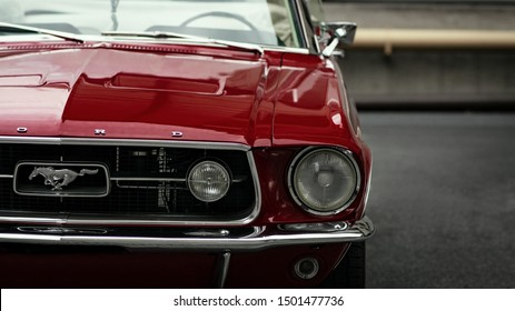 Milan, Italy - August 25 2019 Ford Mustang detail view in red color parked. Beautiful design vintage super car.