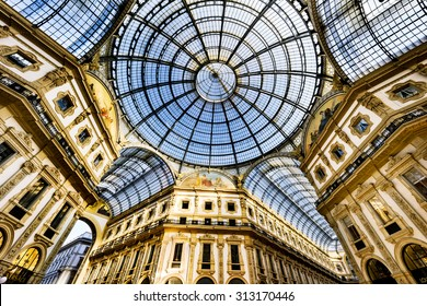 MILAN, ITALY - AUGUST 29, 2015: Galleria Vittorio Emanuele II in Milan. It's one of the world's oldest shopping malls, designed and built by Giuseppe Mengoni between 1865 and 1877.