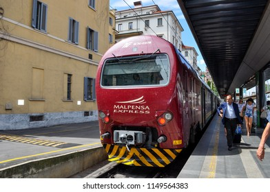 Milan / Italy — August 3, 2010: the Malpensa Express train on the platform of Milano Cadorna railway station. Malpensa Express offers a connection between Malpensa Airport and city center of Milan