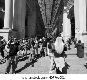 MILAN, ITALY - CIRCA APRIL 2016: Tourists in Piazza Duomo (meaning Cathedral Square) in black and white
