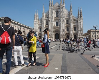 MILAN, ITALY - CIRCA APRIL 2018: People in Piazza Duomo in front of Duomo di Milano (meaning Milan Cathedral)