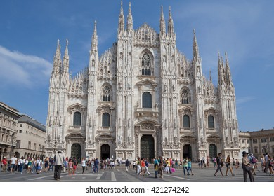 Milan, Italy - Circa August 2013: People walking on central square in front of Duomo.