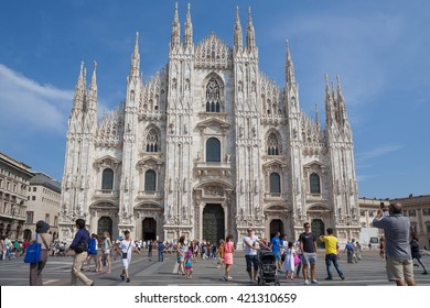 Milan, Italy - Circa August 2013: People walking on Piazza de Duomo in front of cathedral.