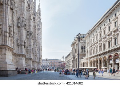 Milan, Italy - Circa August 2013: People walking near Duomo and Galleria Vittorio Emanuele II.